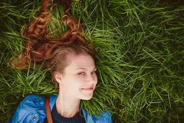 Girl lying on the grass