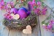 Leinwandbild Motiv Osterkarte - gefärbte Eier im Nest