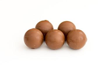 Chocolate truffles isolated on white background