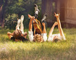 Careless teenagers lying on the green lawn with guitar