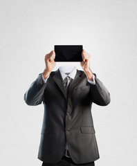 Businessman holding a tablet instead of his head