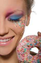 beautiful young woman with donut