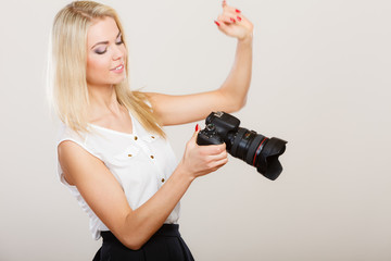 Photographer girl shooting images