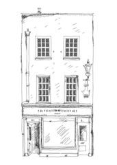 Old English town house with small shop on ground flool
