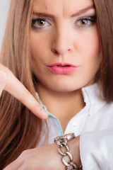 woman showing the time on her wrist watch
