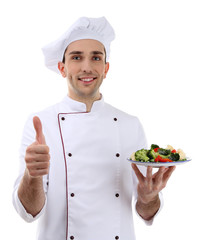 Chef with dish in hand isolated on white