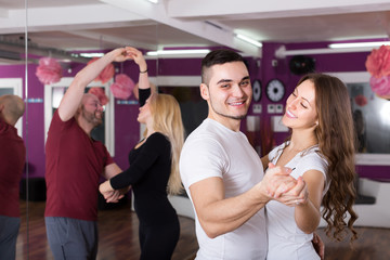 Group dancing in club