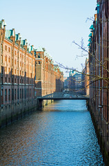 canal in the historic Speicherstadt warehouse district in the ci
