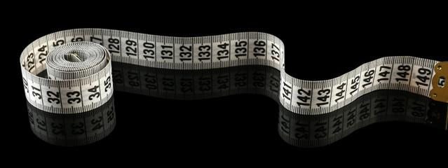 Measuring tape on black background