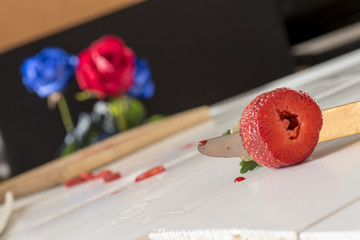 strawberry with a knife