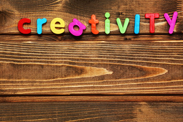 Word creativity on wooden background