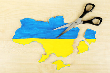 Map of Ukraine and scissors - concept of disintegration of the