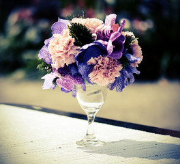 bunch of flowers in glass vase - vintage style effect picture