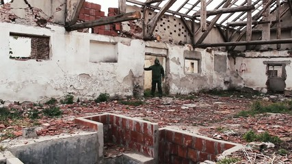 Apocalypse,person in protection suit explore destroyed building