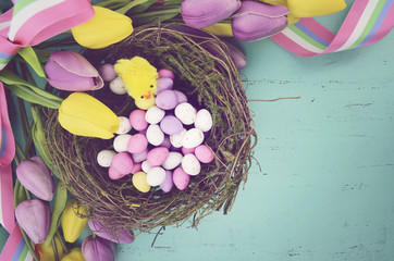 Retro vintage style Easter background with eggs in nest.