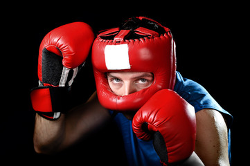 amateur boxer man fighting with boxing gloves and headgear