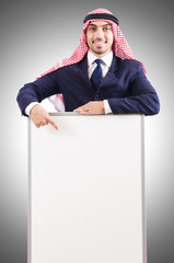 Arab man with blank board for message