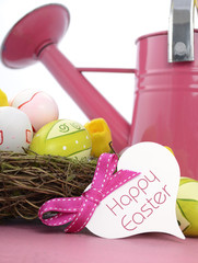 Easter pink watering can with egg decorations