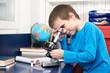 Boy looking in microscope