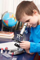 Boy looking in microscope