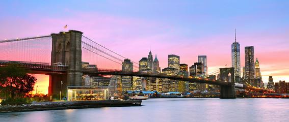 Panoramic view of Manhattan and Brooklyn Bridge at dusk
