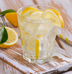 Glass of fresh water with a lemon