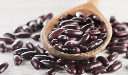 Kidney red beans in a wooden  spoon.