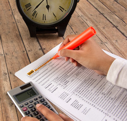 Business women filing income tax