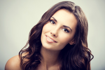 Studio portrait of beautiful young smiling woman