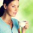 Portrait of smiling young woman drinking coffee