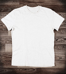 White t-shirt on wood background