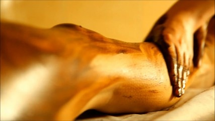 The spa tratment with scrub with coffee on the body parts