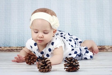 Little baby girl playing with cones