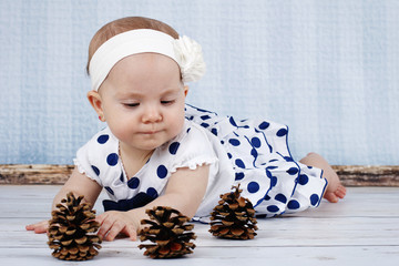 Little toddler playing with cones