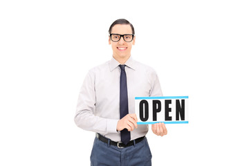 Store manager holding an open sign