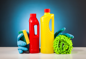 rubber gloves colorful cleaning equipment and blue background