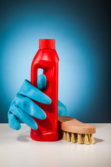rubber glove colorful cleaning  equipment and blue background