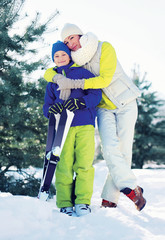 Family healthy lifestyle! Mother and son skiing in the forest