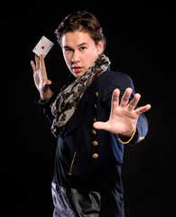 Young magician showing ace