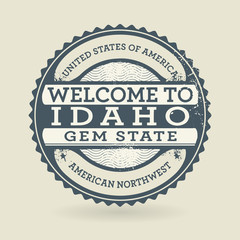Grunge rubber stamp with text Welcome to Idaho, USA