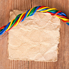 paper and electrical cable on the old wooden background