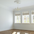 New big empty interior design with retro chandelier and windows