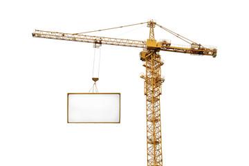 single yellow hoisting crane and advertisement hoardin
