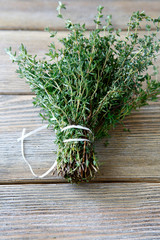 Fragrant thyme on wooden boards