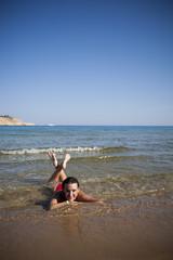 Woman resting on beach