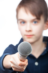 Boy holding microphone, focus on mic
