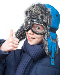 Boy in winter clothing showing thumb up