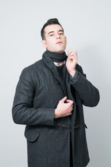 Portrait of a smart, fashion young man with scarf and wool coat