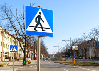 Pedestrian crossing signs on the street.