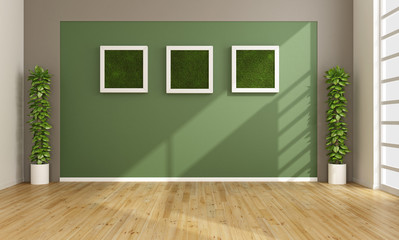 Empty living room with vertical grass in frame
